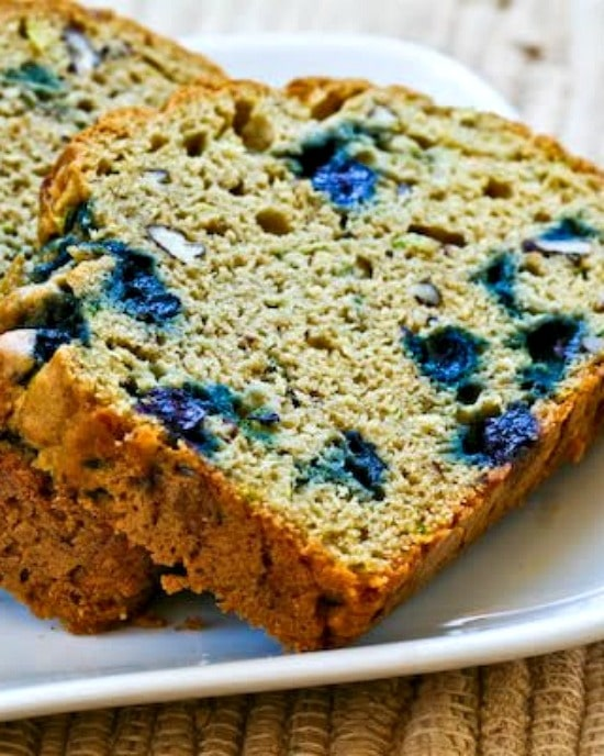 Low-Sugar Whole Wheat Zucchini Bread with Blueberries, sliced bread on plate