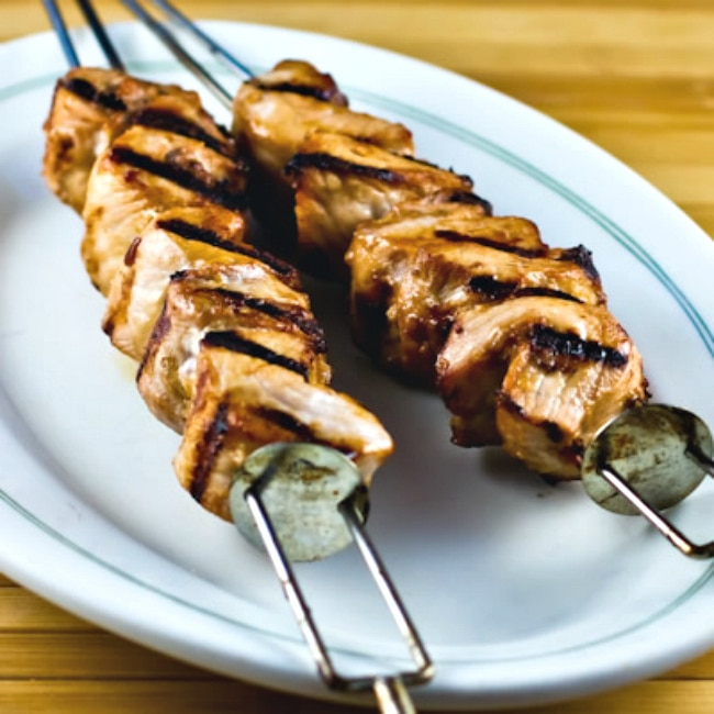 Grilled Pork Kabobs with Peanut-Sesame Marinade finished kabobs on plate
