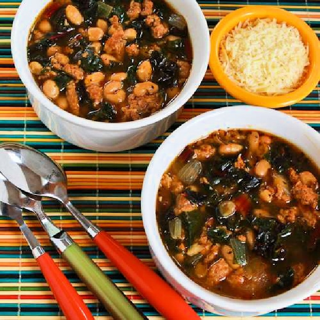 Sausage and Bean Soup with Chard square image of two bowls of soup with Parmesan