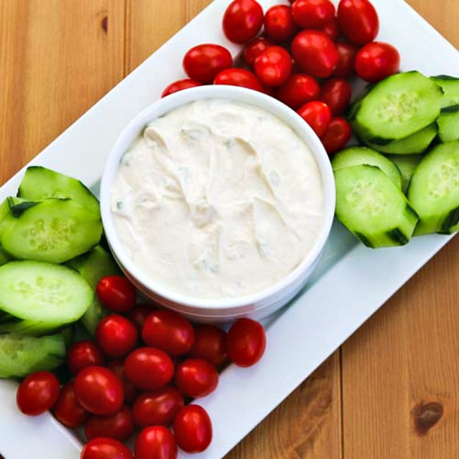 Greek Yogurt Dip finished dip serving platter with tomatoes and cucumbers