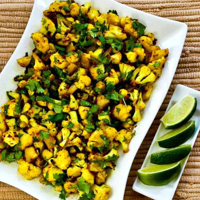 Curried Sauteed Cauliflower photo of cauliflower on plate with lime slices