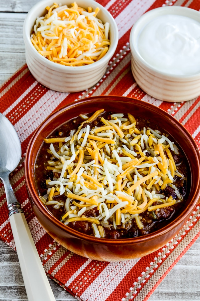 Pumpkin Chili with Ground Beef finished chili in bowl with toppings