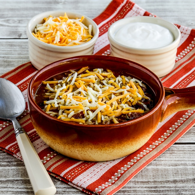 Pumpkin Chili with Ground Beef thumbnail image of chili in bowl with toppings on the side