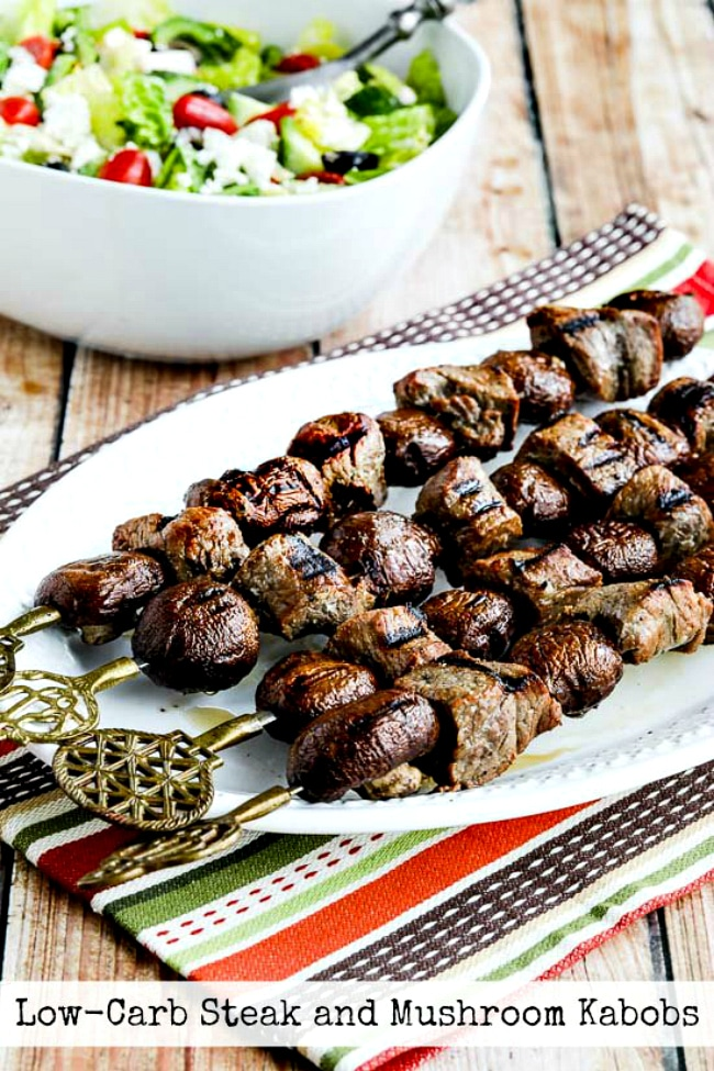 Low-Carb Steak and Mushroom Kabobs finished kabobs on plate photo with text overlay