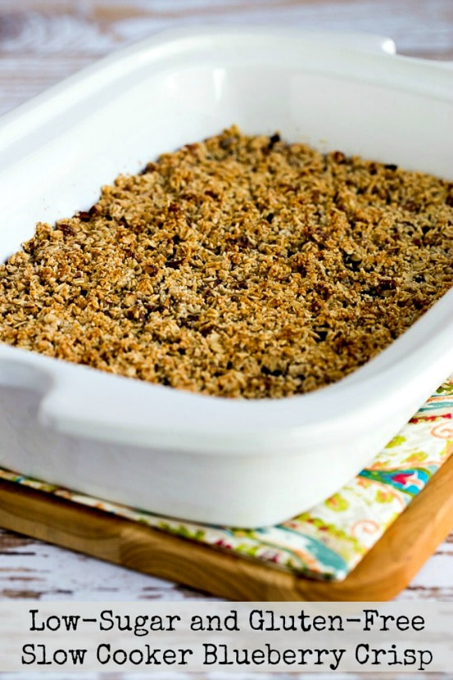 Slow Cooker Blueberry Crisp in casserole crock with text overlay