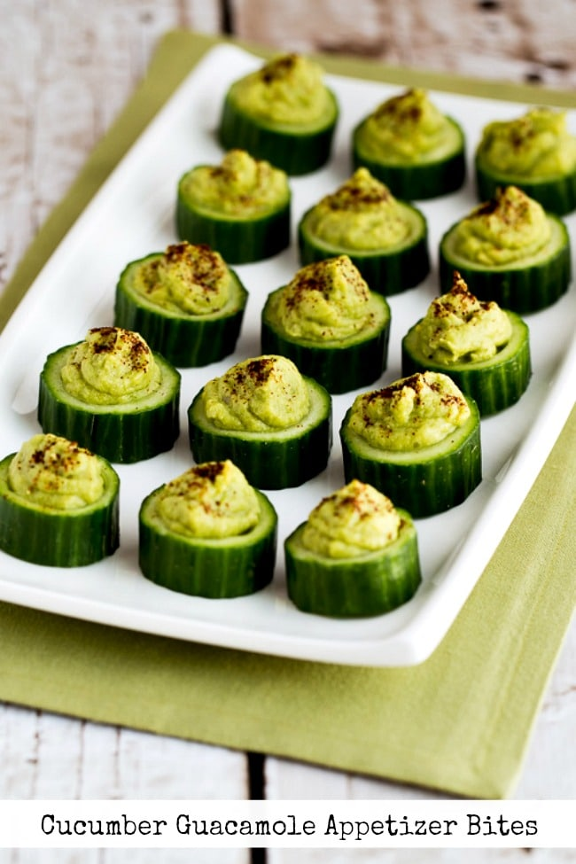 Cucumber Guacamole Appetizer Bites finished appetizers on plate. text overlay photo